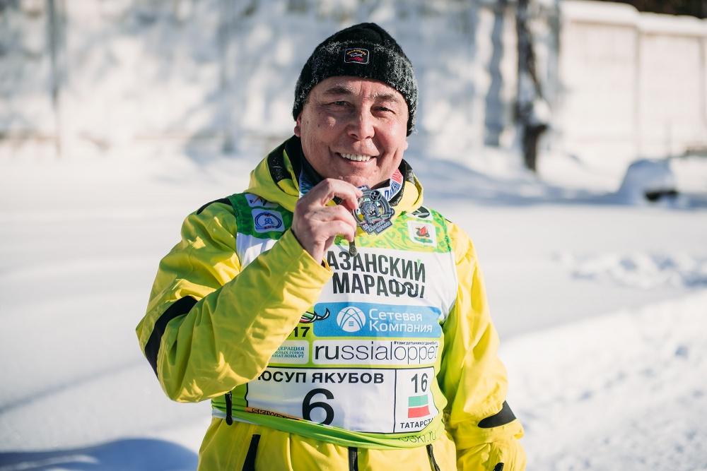 Финишер с медалью марафона